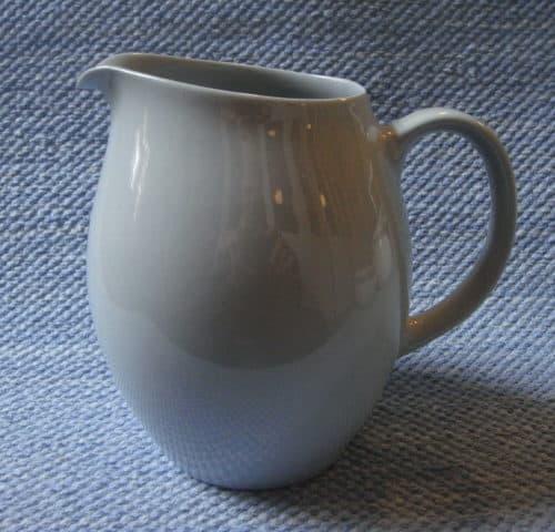 X-mallin maitokannu