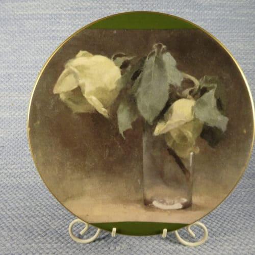 Keltaisa ruusuja lasissa