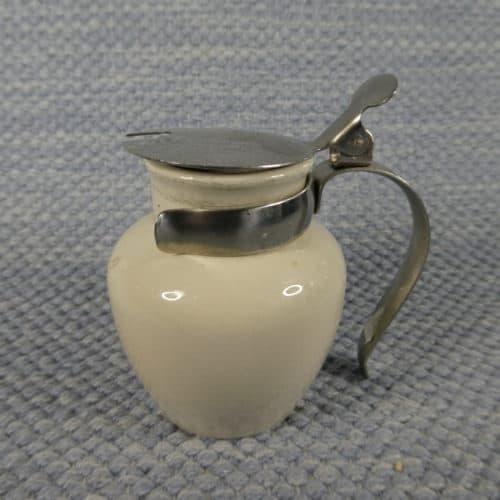 Metallinen kansi/kahva